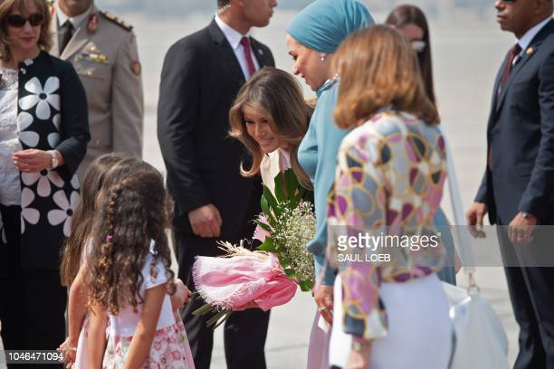 US First Lady Melania Trump alongside Intissar Amer alSisi the First Lady of Egypt greets flower girls after disembarking from her military airplane...