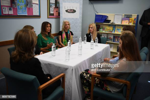 First Lady Melania Trump and advisor Kellyanne Convay attend a roundtbale at Lily's Place, the US first nonprofit infant recovery center that...