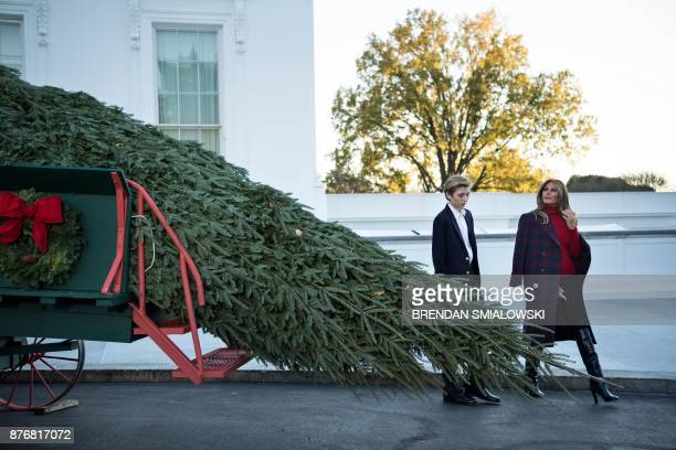 US first lady Melania Trump and Barron Trump arrive to receive a Christmas tree during an event at the White House November 20 2017 in Washington DC...