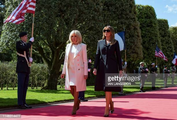 US First Lady Melania Trump and Brigitte Macron arrive to attend a FrenchUS ceremony at the Normandy American Cemetery and Memorial in...
