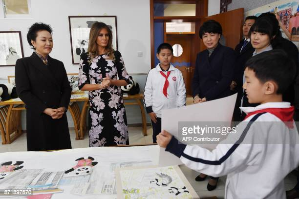 First Lady Melania Trump and China's First Lady Peng Liyuan are shown an art work in a calligraphy class during a visit to Banchang Primary School in...