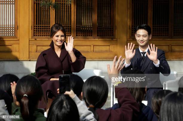 S first lady Melania Trump and Choi Minho a member of South Korean boy band Shinee wave during the Girls Play 2 Initiative an Olympic public...