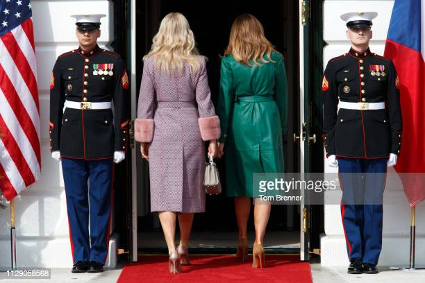 First lady Melania Trump and Czech Republic first lady Monika Babiová enter the White House at the South Portico on March 7 2019 in Washington DC