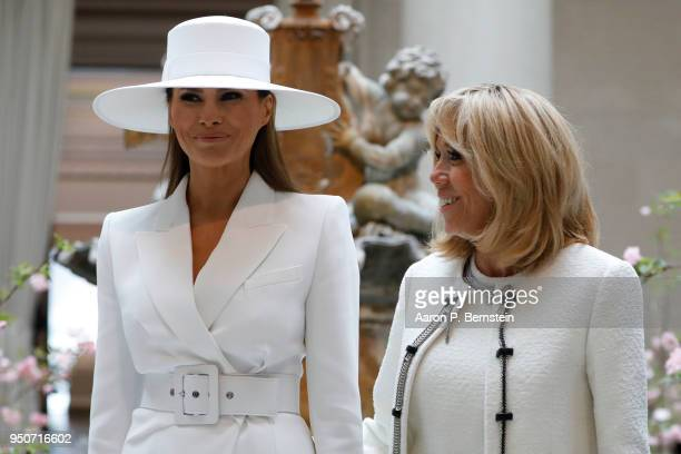 First Lady Melania Trump and French first lady Brigitte Macron tour the National Gallery of Art on April 24 2018 in Washington DC President Donald...