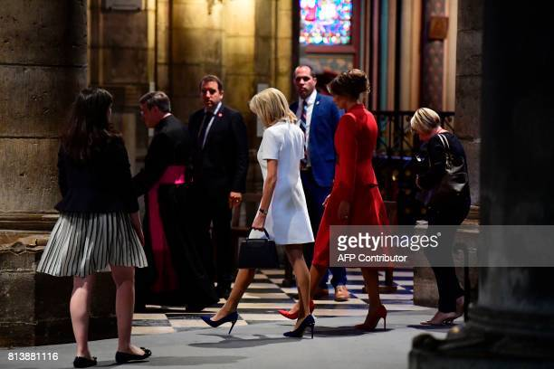 First Lady Melania Trump and French president's wife Brigitte Macron visit Notre Dame Cathedral in Paris, on July 13, 2017. / AFP PHOTO / POOL /...