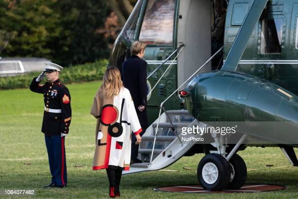 First lady Melania Trump and her son Barron board Marine One prior to their departure from the White House in Washington DC on Tuesday November 20...