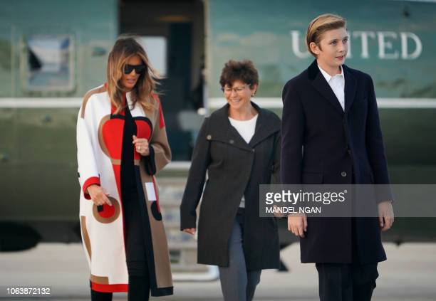US First Lady Melania Trump and her son Barron make their way to board Air Force One before departing from Andrews Air Force Base in Maryland for...