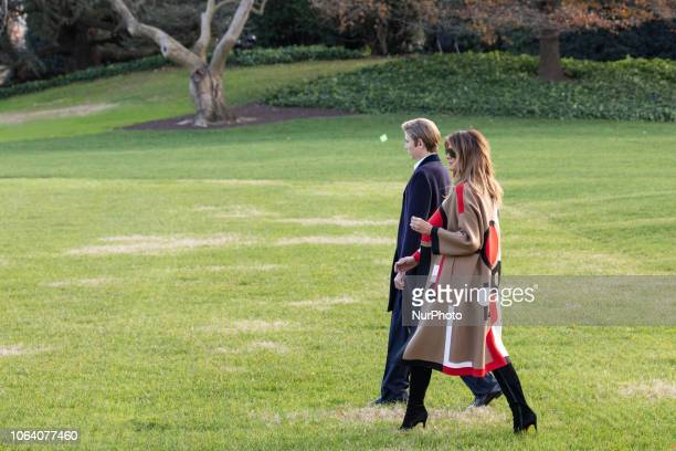 First lady Melania Trump and her son Barron walk across the South Lawn prior to their departure from the White House in Washington DC on Tuesday...
