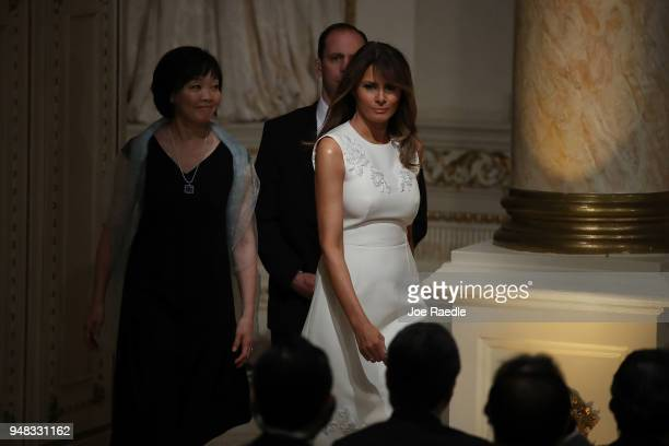 S first lady Melania Trump and Japanese first lady Akie Abe arrive before the start of a news conference held by President Donald Trump and Prime...