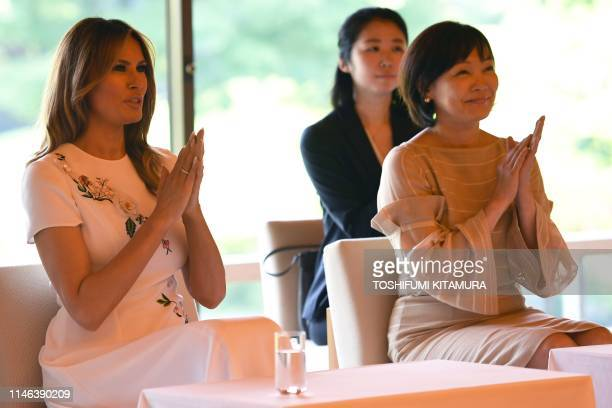 US First Lady Melania Trump and Japanese Prime Minister Shinzo Abes wife Akie Abe watch an artist playing a traditional bamboo flute or shakuhachi in...