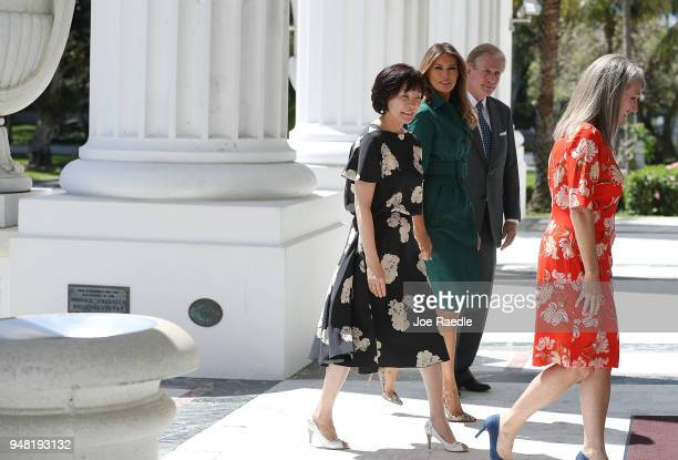 S first lady Melania Trump and Japan's first lady Akie Abe are greeted by Erin Manning executive director of the Flagler Museum and William Matthews...