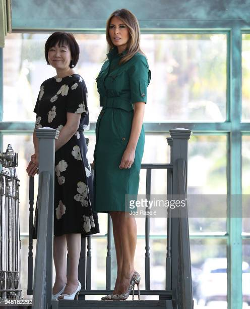S first lady Melania Trump and Japan's first lady Akie Abe stand together during a tour of the Flagler museum on April 18 2018 in Palm Beach Florida...