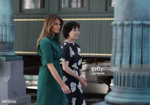 S first lady Melania Trump and Japan's first lady Akie Abe walk together during a tour of the Flagler museum on April 18 2018 in Palm Beach Florida...