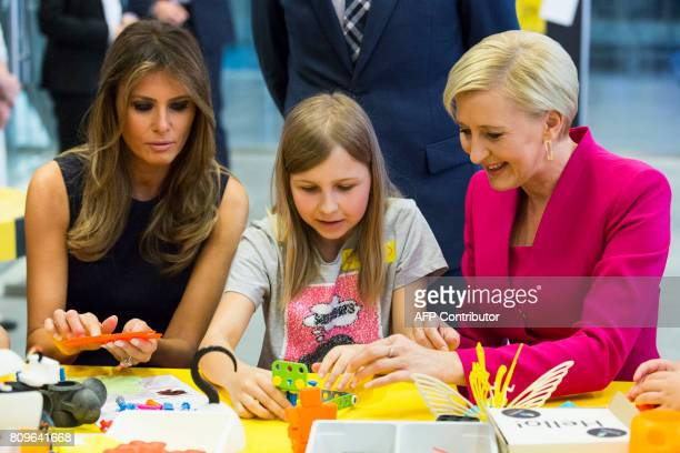 First Lady Melania Trump and Polish President's wife Agata KornhauserDuda play with children as they visit the Copernicus Science Center in Warsaw on...