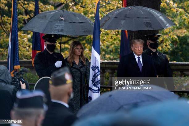 First Lady Melania Trump and President Donal Trump arrive for a wreath laying ceremony at the Tomb of the Unknown Soldier for Veterans Day at...