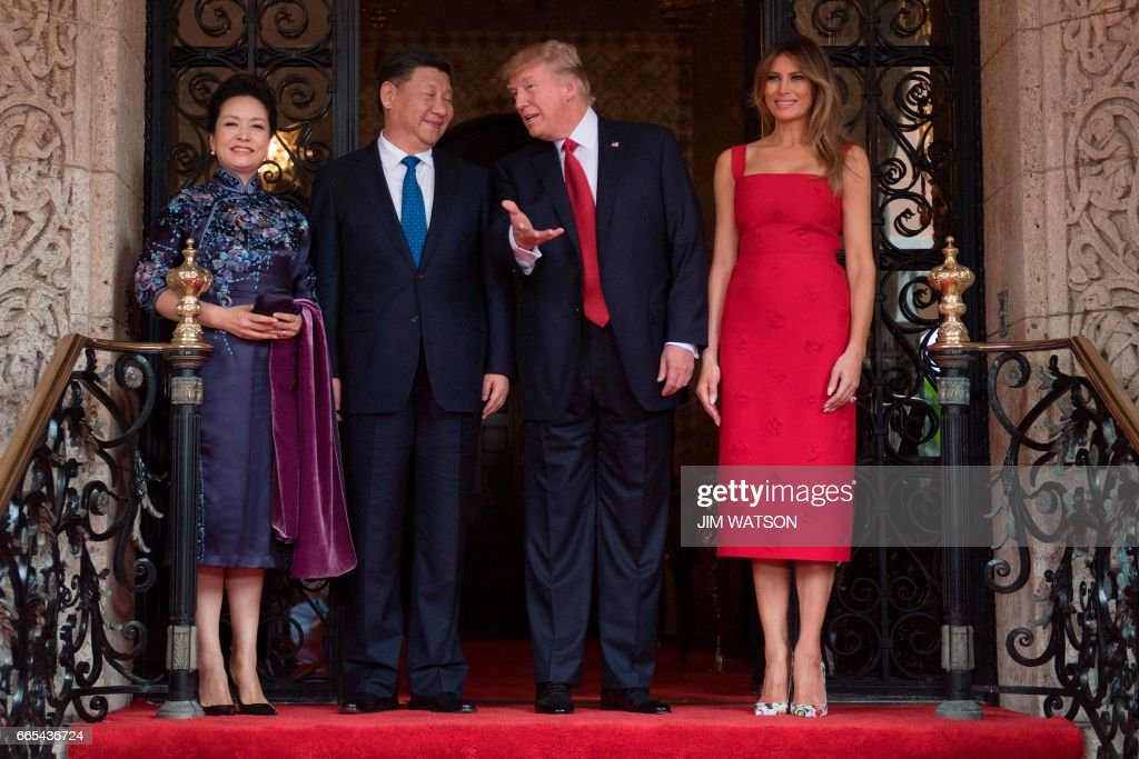 US First Lady Melania Trump (R) and President Donald Trump (2nd R) pose with Chinese President Xi Jinping (2nd L) and his wife Peng Liyuan (L) upon their arrival to the Mar-a-Lago estate in West Palm Beach, Florida, on April 6, 2017. /