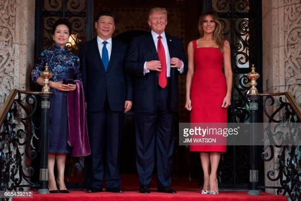 First Lady Melania Trump and President Donald Trump pose with Chinese President Xi Jinping and his wife Peng Liyuan upon their arrival to the...