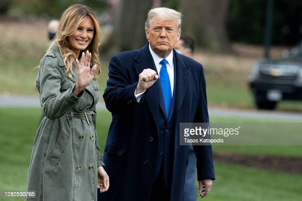 First Lady Melania Trump and President Donald Trump walk on the south lawn of the White House on October 27, 2020 in Washington, DC. President Trump...