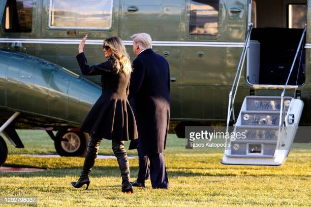 First lady Melania Trump and President Donald Trump walk on the south lawn of the White House on December 23, 2020 in Washington, DC. The Trumps are...