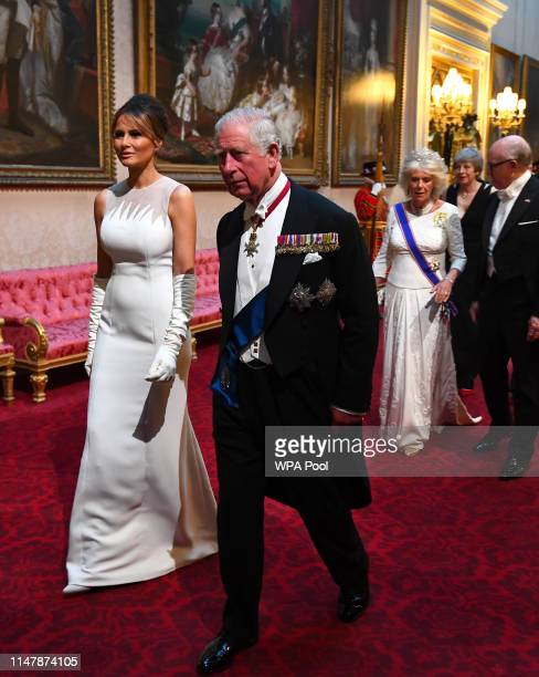 First Lady Melania Trump and Prince Charles, Prince of Wales arrive through the East Gallery for a State Banquet at Buckingham Palace on June 3, 2019...