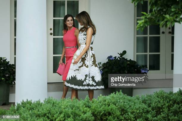 S first lady Melania Trump and Queen Letizia of Spain walk along the Rose Garden Colonnade before entering the Oval Office at the White House June 19...