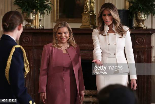 First lady Melania Trump and Sara Netanyahu , wife of Israel Prime Minister Benjamin Netanyahu, arrive at the East Room of the White House prior to a...