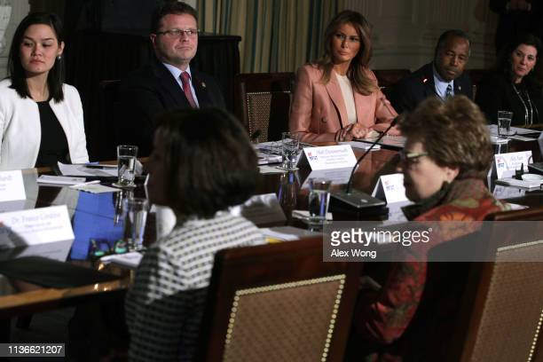 S first lady Melania Trump and Secretary of Housing and Urban Development Ben Carson listen during an Interagency Working Group on Youth Programs...