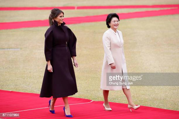 US First Lady Melania Trump and South Korean first lady Kim JungSook walk during a welcoming ceremony held at the presidential Blue House on November...