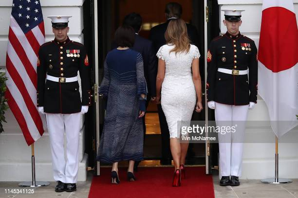 S first lady Melania Trump and the Japanese Prime Minister's wife Akie Abe walk into to the White House April 26 2019 in Washington DC US President...