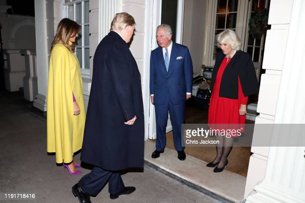 First lady Melania Trump and US President Donald Trump are greeted by Prince Charles, Prince of Wales and Camilla, Duchess of Cornwall as they attend...
