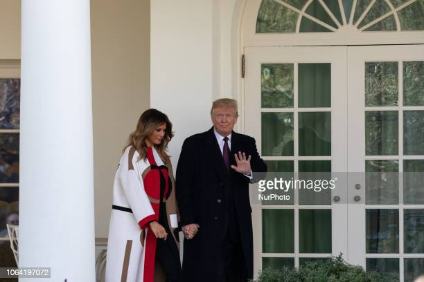 First Lady Melania Trump and US President Donald Trump walk out to the ceremony to pardon the National Thanksgiving Turkey Peas in the Rose Garden at...