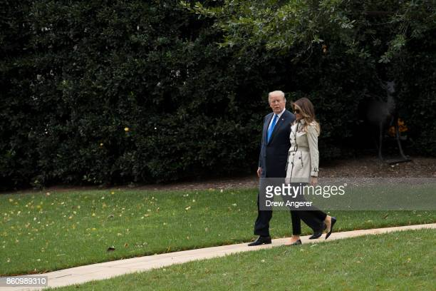 First Lady Melania Trump and US President Donald Trump walk to Marine One on the South Lawn of the White House October 13 2017 in Washington DC The...