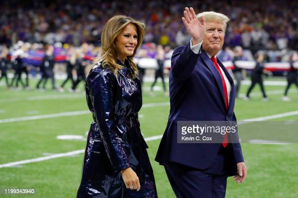 First Lady Melania Trump and U.S. President Donald Trump wave prior to the College Football Playoff National Championship game between the Clemson...