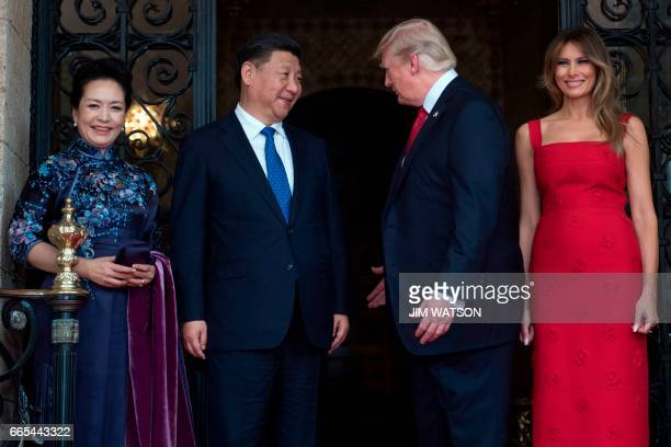 First Lady Melania Trump and US President Donald Trump welcome Chinese President Xi Jinping and his wife Peng Liyuan to the MaraLago estate in West...
