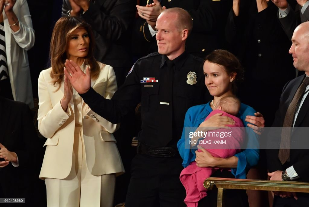 783bf4530d First Lady Melania Trump applauds as Police Officer Ryan Holets his ...
