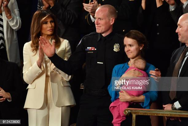 First Lady Melania Trump applauds as Police Officer Ryan Holets his wife Rebecca and adopted daughter Hope are recognized during the State of the...