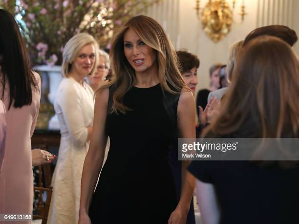 First lady Melania Trump arrives at a luncheon she was hosting to mark International Women's Day in the State Dining Room at the White House March 8...