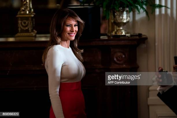 US First Lady Melania Trump arrives for a Hispanic Heritage Month event in the East Room of the White House October 6 2017 in Washington DC President...