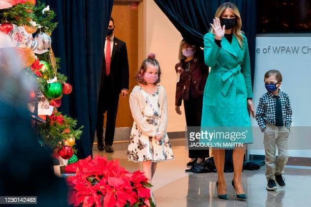 First lady Melania Trump arrives to read a Christmas story with Sofia Martinez and Riley Whitney both children who are patients at Children's...