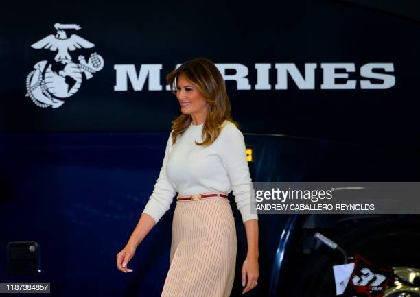 US First Lady Melania Trump arrives to speak at the annual Marine Toys for Tots program hosted by the US Marine Corps Reserve at Joint Base...