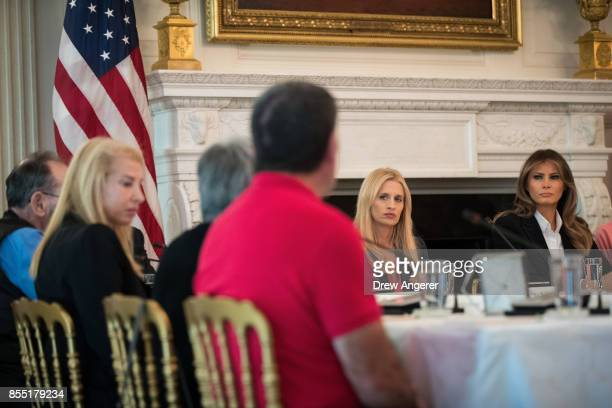 First Lady Melania Trump attends a listening session regarding the opioid crisis in the State Dining Room of the White House September 28 2017 in...