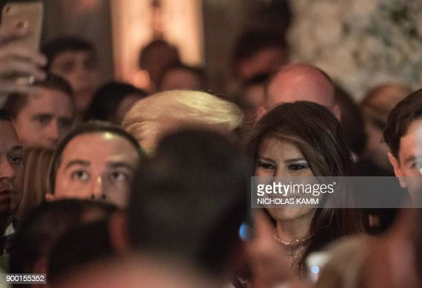 US First Lady Melania Trump attends a New Year's party at his MaraLago resort in Palm Beach Florida on December 31 2017 / AFP PHOTO / NICHOLAS KAMM