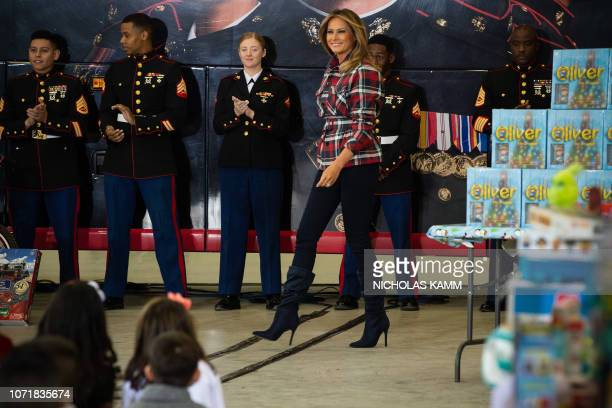 US First Lady Melania Trump attends a Toys for Tots event at Joint Base AnacostiaBolling in Washington DC on December 11 2018 Toys for Tots is a...