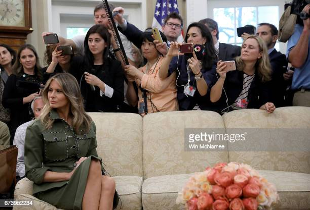 S first lady Melania Trump attends the Oval Office meeting between US President Donald Trump President Mauricio Macri of Argentina and the first lady...