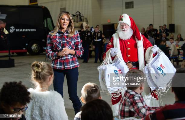 US First Lady Melania Trump attends with Father Christmas personificator a Toys for Tots event at Joint Base AnacostiaBolling in Washington DC on...