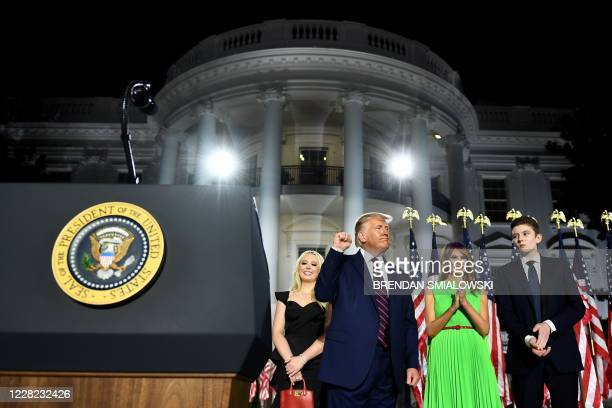 First Lady Melania Trump , Barron Trump and Tiffany Trump stand with US President Donald Trump as he pumps his fist after he delivered his acceptance...
