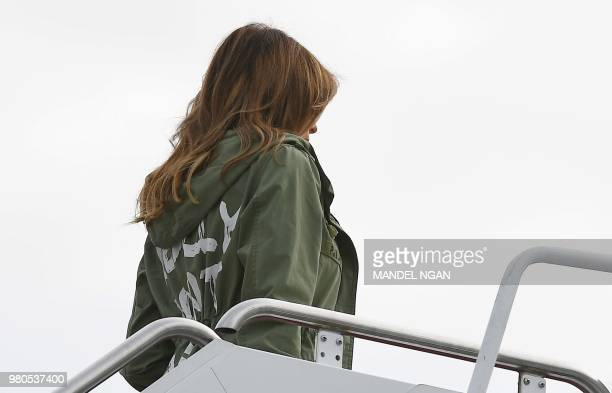 US First Lady Melania Trump boards a flight at Andrews Air Force Base in Maryland on June 21 2018 wearing a rain jacket that reads I really dont care...
