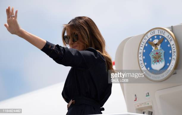 First Lady Melania Trump boards a military airplane prior to departing from Huntington-Tri State Airport in Huntington, West Virginia, July 8 as she...