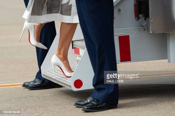 US First Lady Melania Trump boards a military airplane upon departure from Nashville International Airport in Nashville Tennessee July 24 following...