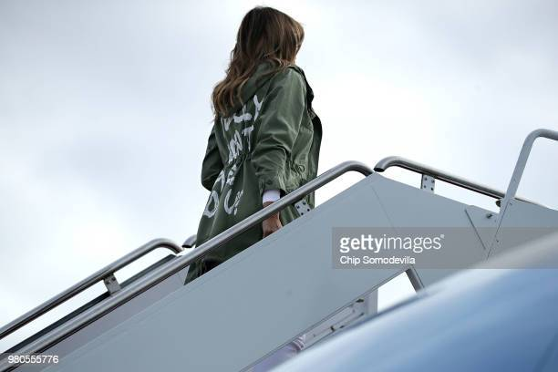 S first lady Melania Trump boards an Air Force plane before traveling to Texas to visit facilities that house and care for children taken from their...